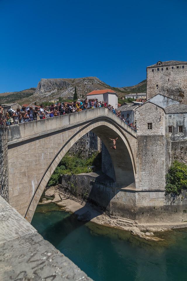 Man jumping Stari Most in Mostar