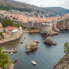 DUBROVNIK, CROATIA - 11TH AUGUST 2016: A view towards Old Town Dubrovnik during the day in the summer showing the outside of the walls and buildings