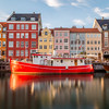 Buildings along the Nyhavn in Copenhagen and a famous red boat