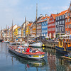 Tour boats and architecture along the Nyhavn in Copenhagen