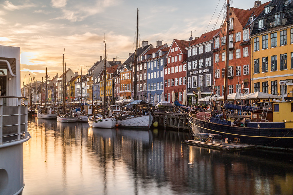 Buildings, architecture and boats along the Nyhavn at sunset