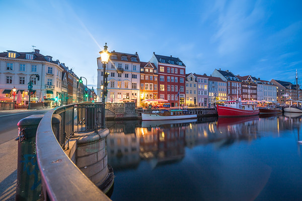 View of architecture and the canal along the Nyhavn at night