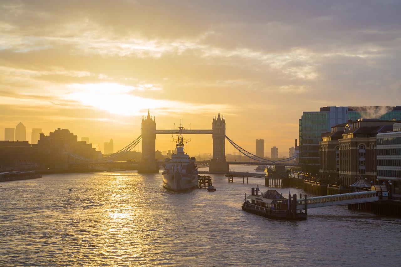 Tower Bridge and HMS Belfast in London at sunrise