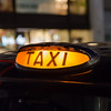 Closeup to a Taxi Sign