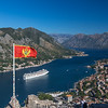 Kotor Skyline, flags, cruise ships and mountains