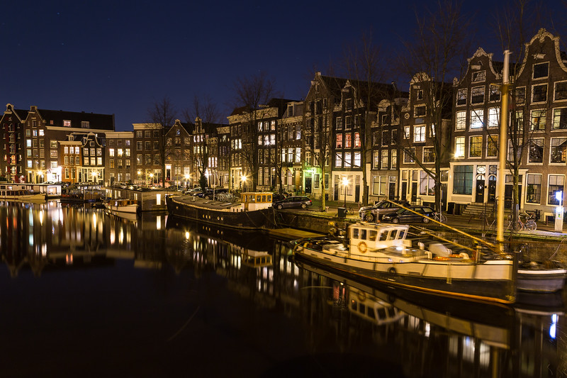 View along the Waalseilandgracht Canal in Amsterdam at night