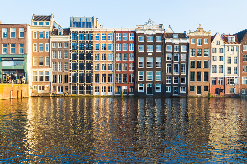 Buildings along the Damrak during the day in Amsterdam