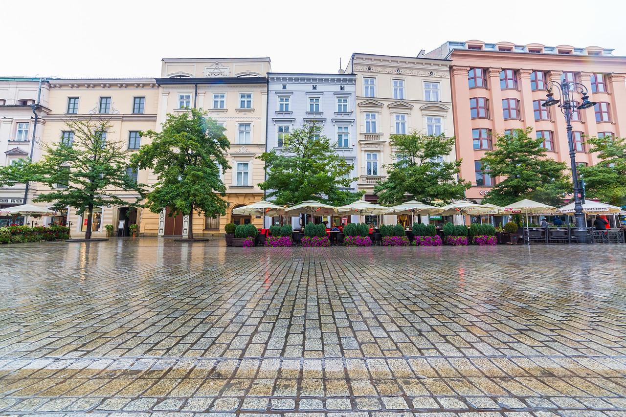 Buildings along Rynek Glowny in Krakow in the morning
