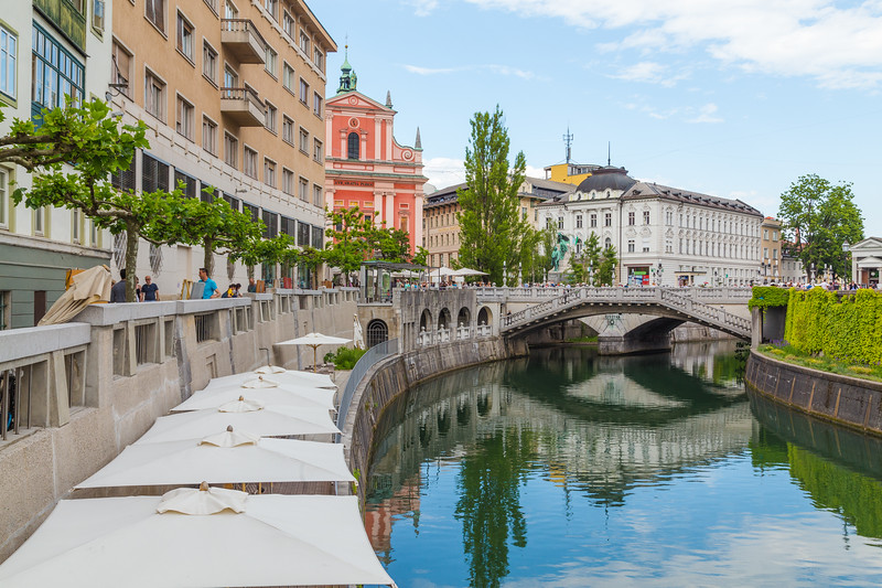 View along the Ljubljana canal towards the Franciscan Church of the Annunciation