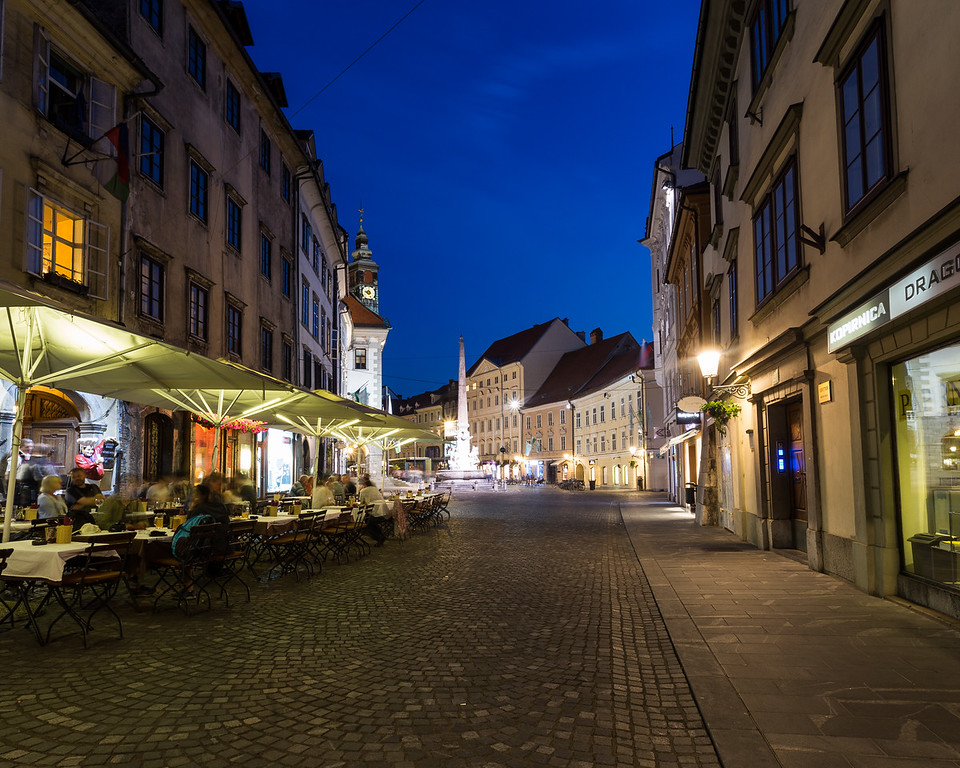 Buildings and streets in Town Square Ljubljana at night