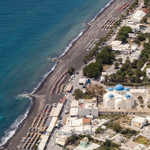 Perissa Beach and Holy Cross Church