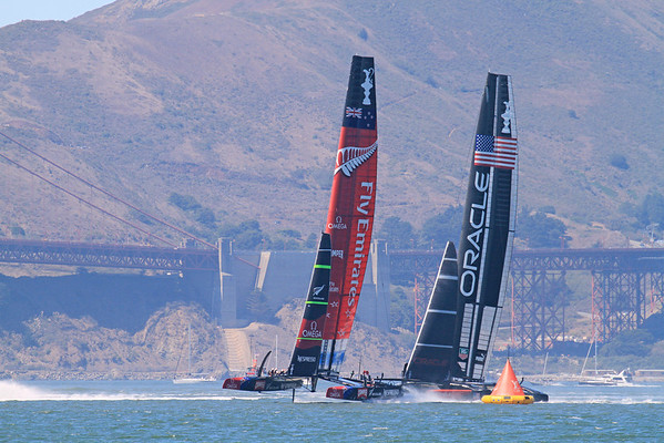 USA Oracle rounds the mark and leads in the 3rd race to win her first of the America's Cup 2013