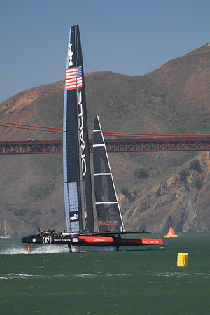 USA Oracle, flying a hull on her hydrofoils; America's Cup 2013