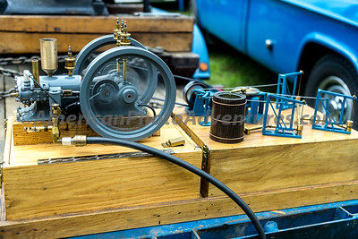 This is a working miniature of a single engine running three oil pumps.