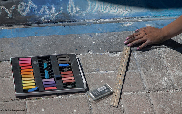 Artist hand during Chalk the Block 2012