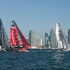 The America's Cup Trials in San Diego harbor, in AC45 Catamarans, racing in front of the San Diego downtown skyline,