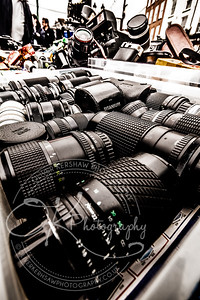 box of old camera lenses