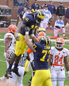 Denard touchdown  with Taylor Lewan