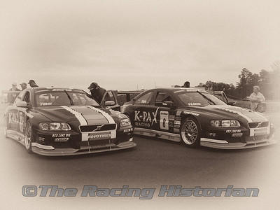 Andy Pilgrim and Randy Pobst in their K-Pax Volvo S60s in the staging area prior to the race.
