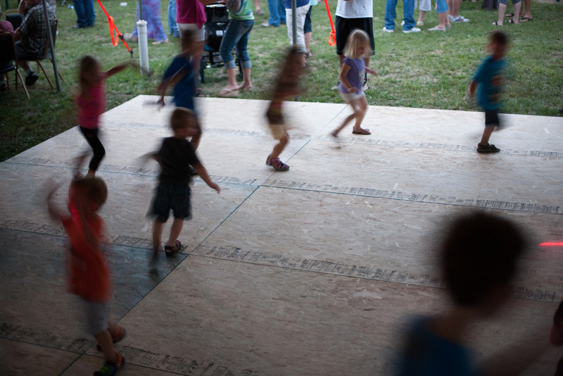 Children dancing to Abby Road under the tent