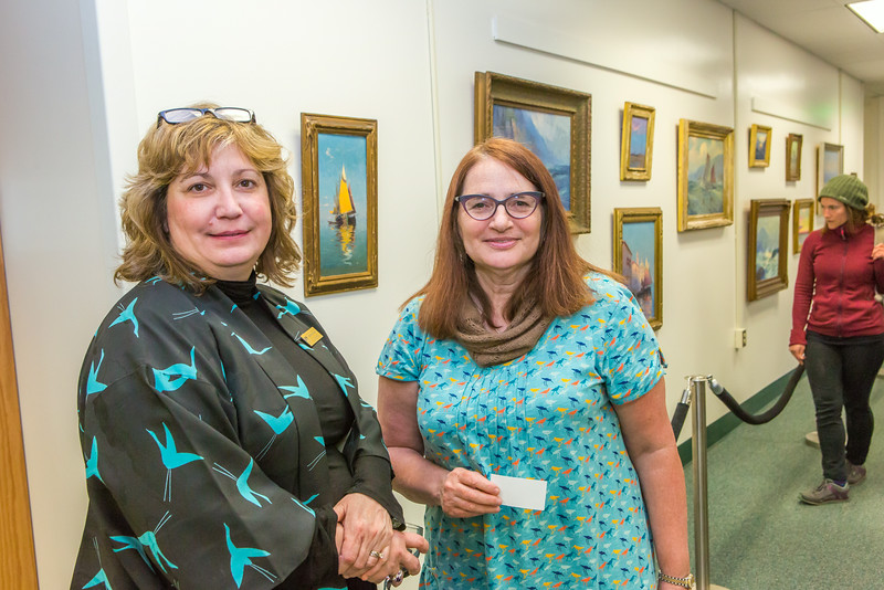 """UAF Dean of Libraries Bella Gerlich, left, visits with alumna Mary Albanese during a reception in the Rasmuson Library May 23. Albanese and her husband Tom, also a UAF alum, donated a series of original paintings by Sydney Lawrence to the library from their personal collection.  <div class=""""ss-paypal-button"""">Filename: DEV-14-4202-51.jpg</div><div class=""""ss-paypal-button-end""""></div>"""