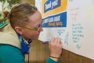 UAF scholarship recipient Porsche Collette takes some time of her schedule to add a personal message to a thank you poster during thank-a-donor day in the Wood Center ballroom.  Filename: DEV-13-3726-60.jpg