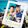 """Graduates surrounded by friends and family pose for a photo after the 2016 commencement ceremony outside the Carlson Center.  <div class=""""ss-paypal-button"""">Filename: GRA-16-4895-140.jpg</div><div class=""""ss-paypal-button-end""""></div>"""
