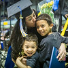 "Ciera Shaver is greeted by her sons Mehki Carter, 3, and Maliek Carter, 5 after crossing the stage at the 2014 UAF Commencement Ceremony Sunday, May 11, 2014 at the Carlson Center.  <div class=""ss-paypal-button"">Filename: GRA-14-4187-248.jpg</div><div class=""ss-paypal-button-end""></div>"