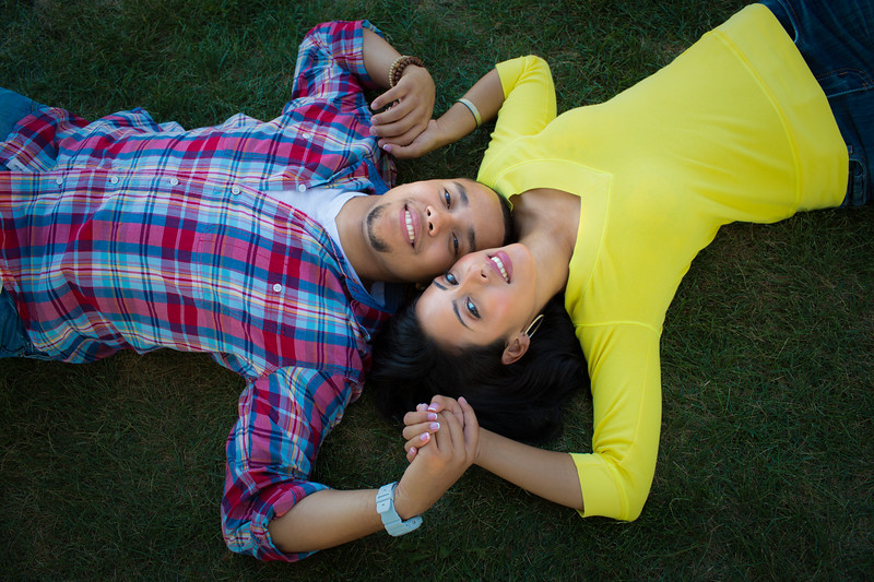 Two Hispanic Couple Lying on Engagement PictureEngagement Picture