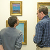 """Patrons of UAF's  Rasmuson Library admire a collection of original paintings by Sydney Lawrence donated to the library from private the collection of alums Tom and Mary Albanese.  <div class=""""ss-paypal-button"""">Filename: DEV-14-4202-28.jpg</div><div class=""""ss-paypal-button-end""""></div>"""