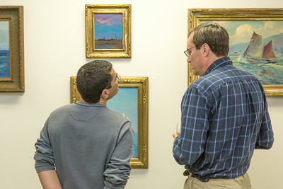 Patrons of UAF's  Rasmuson Library admire a collection of original paintings by Sydney Lawrence donated to the library from private the collection of alums Tom and Mary Albanese.  Filename: DEV-14-4202-28.jpg