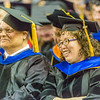 "Ph.D. graduate Yongjun Zhang shares a laugh with her major professor Dukumar Bandopadhyay during UAF's commencement ceremony May 11 in the Carlson Center.  <div class=""ss-paypal-button"">Filename: GRA-14-4186-1087.jpg</div><div class=""ss-paypal-button-end"" style=""""></div>"