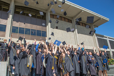 Members of the 30th anniversary graduating class of UAF's Rural Alaska Honors Institute celebrate on the steps of the Rasmuson Library moments after their commencement ceremony July 11.  Filename: GRA-12-3466-222.jpg