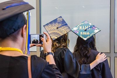 RAHI students take pictures before the 2016 commencement ceremony.  Filename: GRA-16-4932-25.jpg