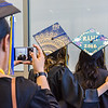 """RAHI students take pictures before the 2016 commencement ceremony.  <div class=""""ss-paypal-button"""">Filename: GRA-16-4932-25.jpg</div><div class=""""ss-paypal-button-end""""></div>"""