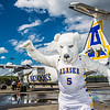 "The Nanook mascot stands by the Era Alaska newly painted Bombardier Dash-8 which features the Alaska Nanooks colors and logo on one side, and a UAA Seawolves treatment on the other.  <div class=""ss-paypal-button"">Filename: DEV-13-3858-106.jpg</div><div class=""ss-paypal-button-end"" style=""""></div>"