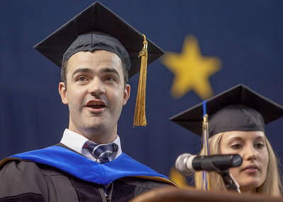 Walter Fourie was awarded his Ph.D. in environmental engineering and was selected to sing a verse of the Alaska Flag Song during at UAF's commencement ceremony in the Carlson Center.  Filename: GRA-12-3410-0905.jpg