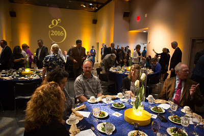 Guests take their seats at the dining tables in the UA Museum of the North auditorium for the 2016 Gold Banquet, an annual event for UAF honorary degree recipients and commencement special guests.  Filename: GRA-16-4894-148.jpg