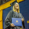 "Erin Otness smiles to her family in the crowd after accepting her bachelor's degree in elementary education during UAF's commencement ceremony May 11 in the Carlson Center.  <div class=""ss-paypal-button"">Filename: GRA-14-4186-0739.jpg</div><div class=""ss-paypal-button-end"" style=""""></div>"