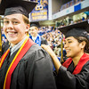 "Shelly DeWilde, right, writes last minute notes on her name card on Luke Dinon during the commencement ceremony at the Carlson Center Sunday, May 8, 2016.  <div class=""ss-paypal-button"">Filename: GRA-16-4896-490.jpg</div><div class=""ss-paypal-button-end""></div>"