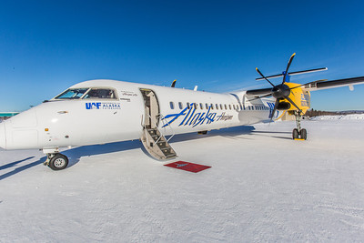 One of Alaska Airlines' newest aircraft is a Bombardier Q400 turboprop featuring the Alaska Nanooks and UAF.  Filename: DEV-14-4080-17.jpg