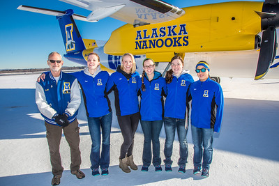 Members of the UAF swim team pose by one of the newest planes in the Alaska Airlines fleet, a Bombardier Q400 turboprop, which features the Alaska Nanooks and UAF.  Filename: DEV-14-4080-88.jpg
