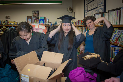 Graduates in the class of 2012 from UAF's Bristol Bay Campus in Dillingham try on their caps and gowns in the comunity library before the commencement ceremony.  Filename: GRA-12-3391-044.jpg