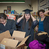 """Graduates in the class of 2012 from UAF's Bristol Bay Campus in Dillingham try on their caps and gowns in the comunity library before the commencement ceremony.  <div class=""""ss-paypal-button"""">Filename: GRA-12-3391-044.jpg</div><div class=""""ss-paypal-button-end"""" style=""""""""></div>"""