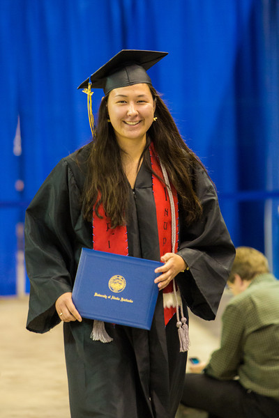 """Sarah Walker returns to her seat after collecting her faux diploma during UAF's commencement ceremony May 11 in the Carlson Center.  <div class=""""ss-paypal-button"""">Filename: GRA-14-4186-0713.jpg</div><div class=""""ss-paypal-button-end"""" style=""""""""></div>"""
