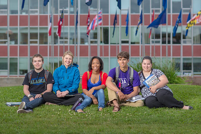 Students pose for a Development photo shoot in front of the Circle of Flags in Cornerstone Plaza. Left to right: Noah Betzen, Caltlin Kaber, Kaleidra Chavis, Adam McCombs, Angie Cocuzza.  Filename: DEV-12-3460-063.jpg