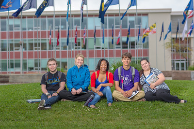 Students pose for a Development photo shoot in front of the Circle of Flags in Cornerstone Plaza. Left to right: Noah Betzen, Caltlin Kaber, Kaleidra Chavis, Adam McCombs, Angie Cocuzza.  Filename: DEV-12-3460-057.jpg