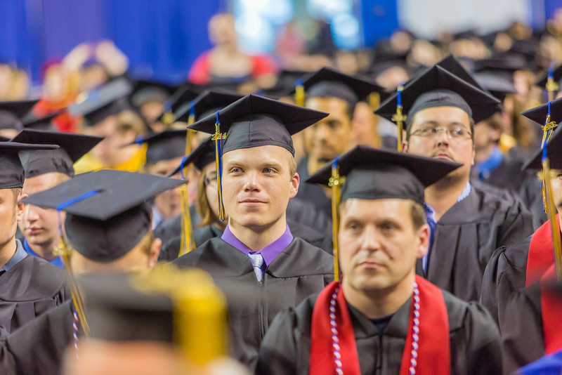 """Members of the graduating class of 2014 listen to the student speaker during UAF's commencement ceremony May 11 in the Carlson Center.  <div class=""""ss-paypal-button"""">Filename: GRA-14-4186-1251.jpg</div><div class=""""ss-paypal-button-end"""" style=""""""""></div>"""