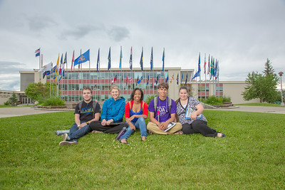 Students pose for a Development photo shoot in front of the Circle of Flags in Cornerstone Plaza. Left to right: Noah Betzen, Caltlin Kaber, Kaleidra Chavis, Adam McCombs, Angie Cocuzza.  Filename: DEV-12-3460-053.jpg