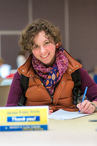 UAF scholarship recipient Heather Currey takes some time of her schedule to write a thank you note during thank-a-donor day in the Wood Center ballroom.  Filename: DEV-13-3726-36.jpg
